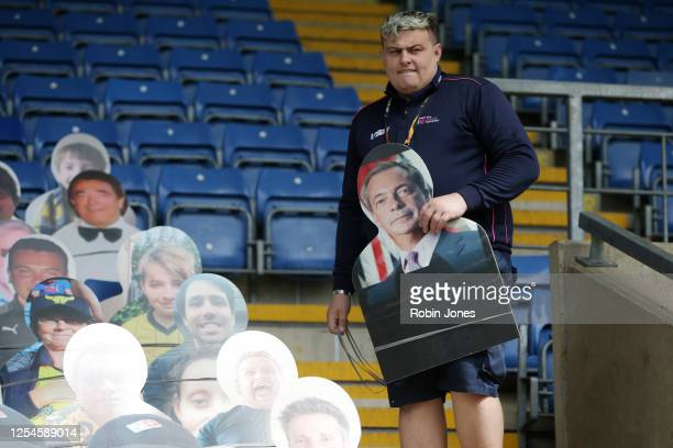 Cardboard cut-out of Nigel Farage is removed from cut-outs of Oxford Utd fans in the stands ahead of the Sky Bet League One Play Off Semi-final 2nd...