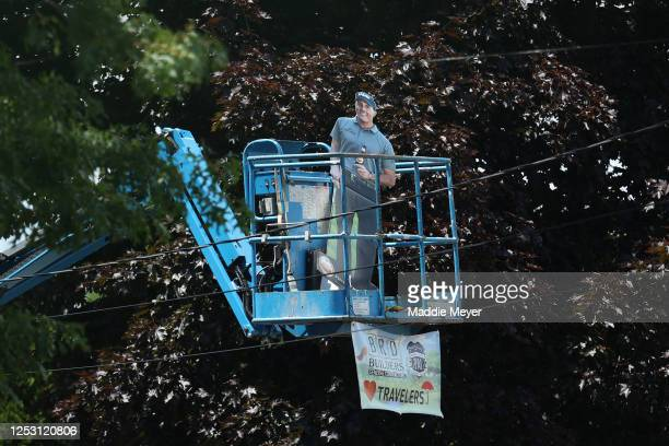 A cardboard cutout of Phil Mickelson of the United States is seen on a scissor lift during the final round of the Travelers Championship at TPC River...