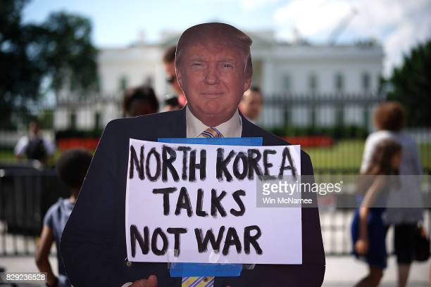 A cardboard cutout of US President Donald Trump is shown during a protest against escalating threats of military action in North Korea August 10 2017...