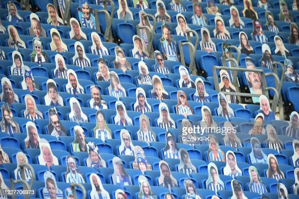 Cardboard cutout pictures of football supporters are seen in the stands ahead of the English Premier League football match between Brighton and Hove...