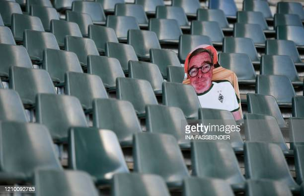 A cardboard cutout with a portrait of a Borussia Moenchegladbach supporter is seen at the Borussia Park football stadium in Moenchengladbach western...