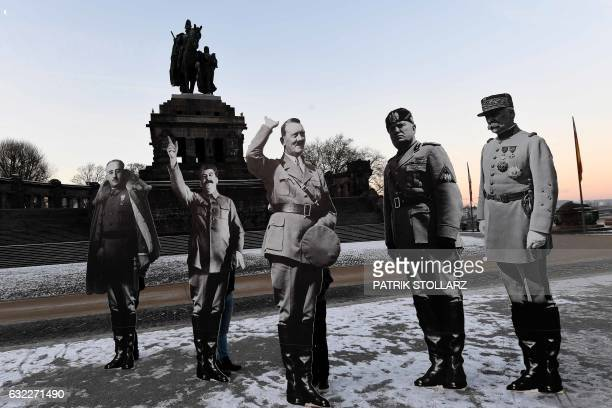 TOPSHOT Cardboard cutouts depicting Spanish dictator Francisco Franco Soviet dictator Joseph Stalin German dictator Adolf Hitler Italian dictator...