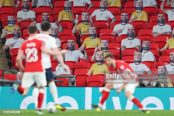 Cardboard cut-outs of England players are seen on the seats in the stands during the FIFA World Cup Qatar 2022 Group I qualification football match...