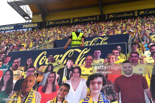 Cardboard cut-outs of fans in the stands prior to the Liga match between Villarreal CF and FC Barcelona at Estadio de la Ceramica on July 05, 2020 in...