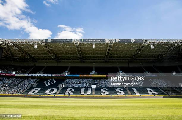 Cardboard cutouts of fans of Bundesliga club Borussia Moenchengladbach fill their stadium on May 14 2020 in Moenchengladbach Germany Borussia...