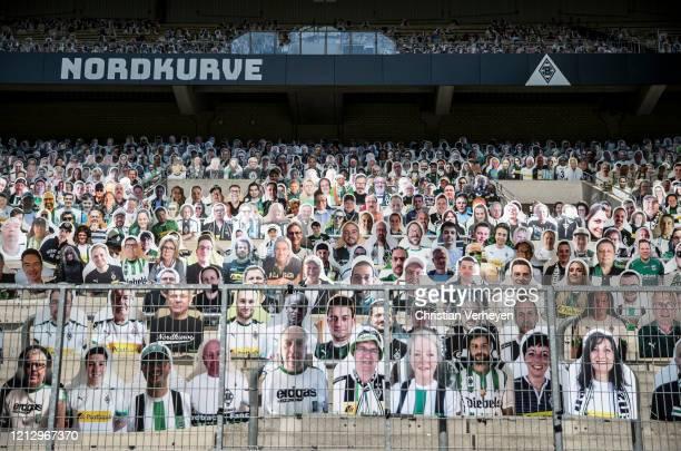 Cardboard cutouts of fans of Bundesliga club Borussia Moenchengladbach fill their stadium on May 14 2020 in Moenchengladbach Germany Borussia...