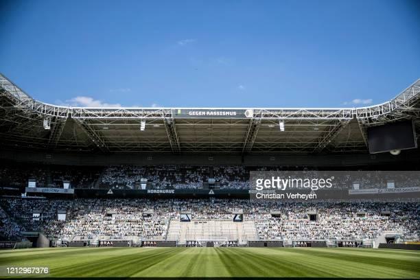 Cardboard cut-outs of fans of Bundesliga club Borussia Moenchengladbach fill their stadium on May 14, 2020 in Moenchengladbach, Germany. Borussia...