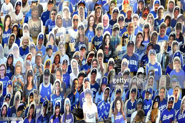 Cardboard cutouts of Los Angeles Dodgers fans are seen in seats before the Opening Day game between the San Francisco Giants and the Los Angeles...