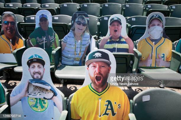 Cardboard cutouts representing fans are seen in the seats during the 2020 Major League Baseball season match between the Los Angeles Angels and the...
