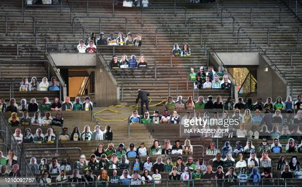 Cardboard cut-outs with portraits of Borussia Moenchegladbach's supporters are seen at the Borussia Park football stadium in Moenchengladbach,...