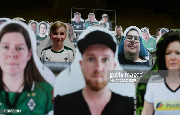 Cardboard cutouts with portraits of Borussia Moenchegladbach's supporters are seen at the Borussia Park football stadium in Moenchengladbach western...