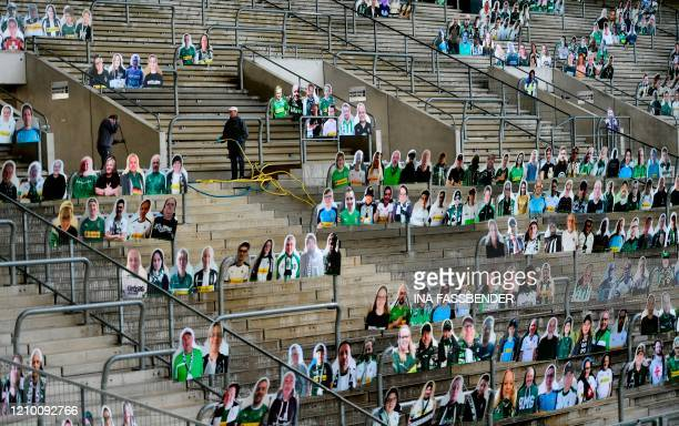 TOPSHOT Cardboard cutouts with portraits of Borussia Moenchegladbach's supporters are seen at the Borussia Park football stadium in Moenchengladbach...