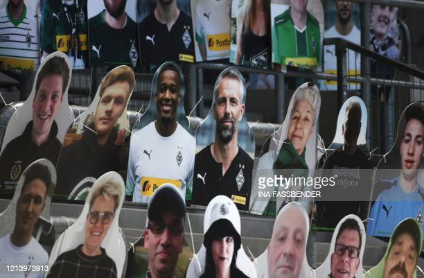 Cardboard cutouts with portraits of Moenchengladbach's French forward Alassane Plea and Moenchengladbach's German head coach Marco Rose are seen...
