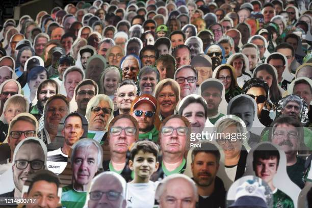 Cardboard cuts outs of fans are seen inside the stadium prior to the Bundesliga match between Borussia Moenchengladbach and Bayer 04 Leverkusen at...