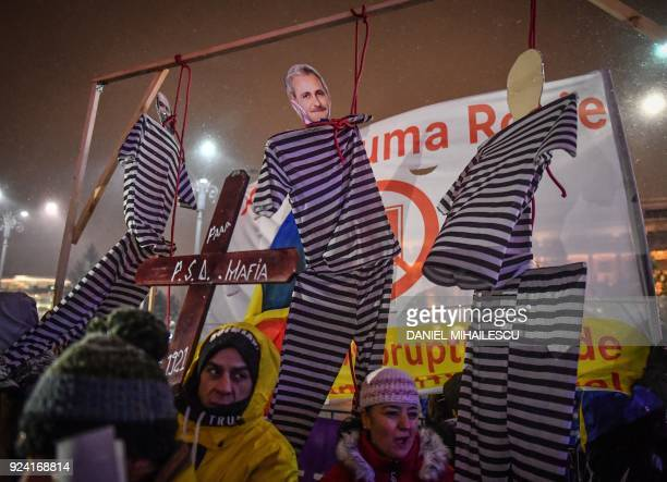 Cardboard depicting a figure of the president of PSD rulling party, Liviu Dragnea is hanged during a protest against the Justice minister and the...