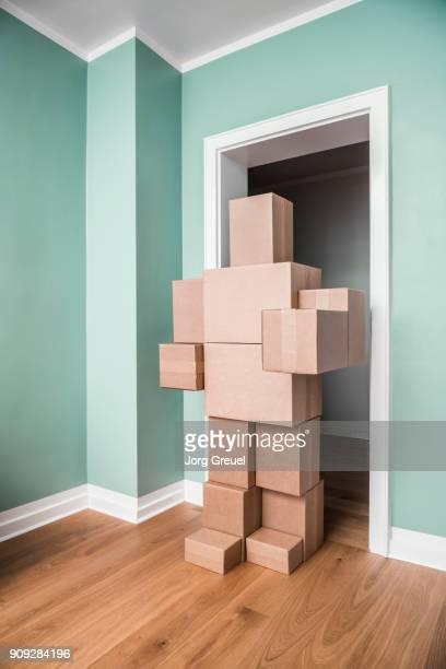 Cardboard man in doorway