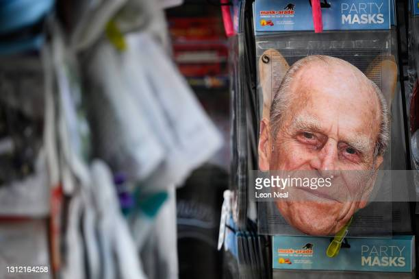 Cardboard masks featuring Prince Philip are seen in a gift shop, as tributes continue to be made to the Duke Of Edinburgh who died at age 99 on April...