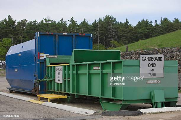 Cardboard Only recycling container connected to compactor