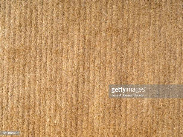 cardboard or paper antique texture background brown color - paperboard stock photos and pictures