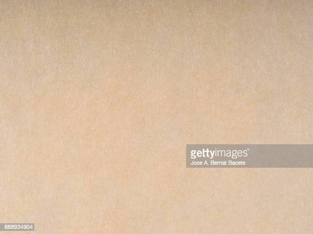 cardboard or paper antique texture background light brown color - cardboard stock pictures, royalty-free photos & images