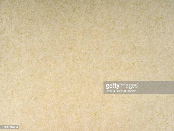 Cardboard or paper antique texture background light brown color
