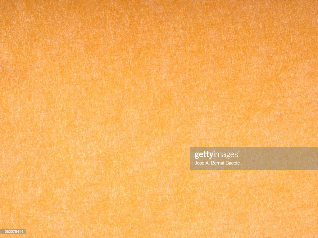 cardboard or paper antique texture background light orange