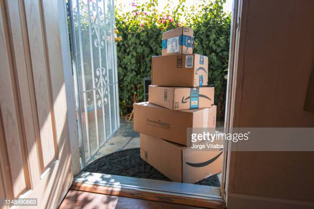 cardboard package delivery at front door - brand name stock pictures, royalty-free photos & images