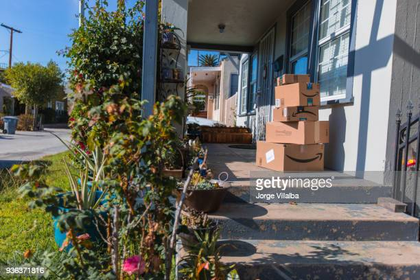 Cardboard package delivery at front door