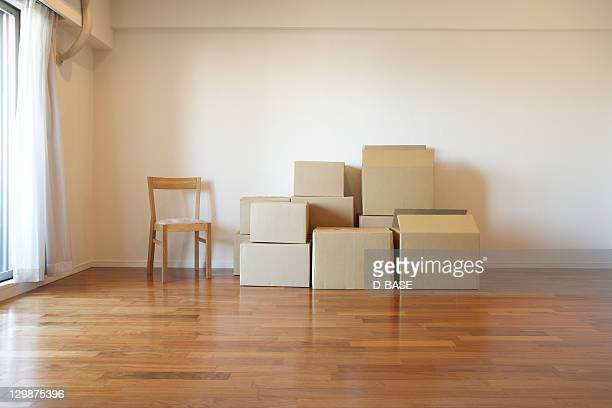 cardboard packaging in an empty apartment