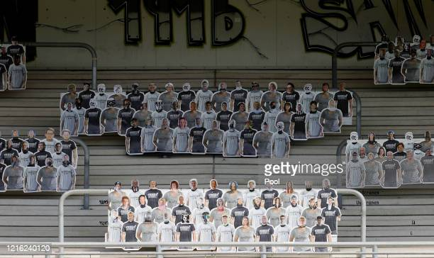 Cardboard pictures of fans are seen in the stands during the Second Bundesliga match between SV Sandhausen and Hannover 96 at BWT-Stadion am...