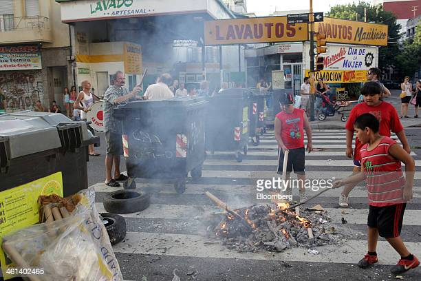 Cardboard tubes are burned on a street in protest in the Flores neighborhood of Buenos Aires Argentina on Tuesday Jan 7 2014 Empresa Distribuidora...