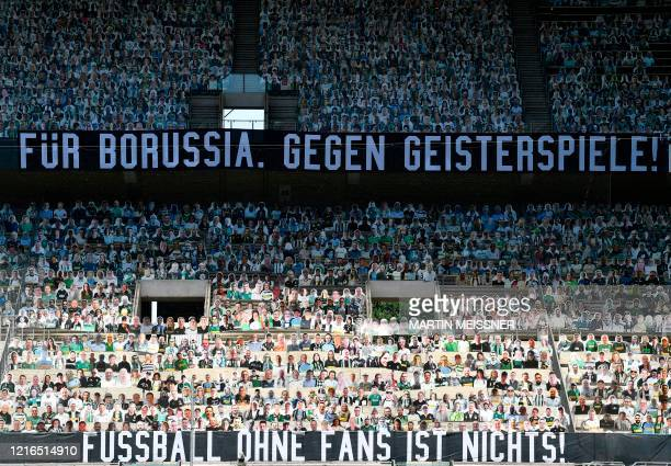 TOPSHOT Cardboards with photos of Moenchengladbach fans are seen on the stands prior to the German first division Bundesliga football match Borussia...