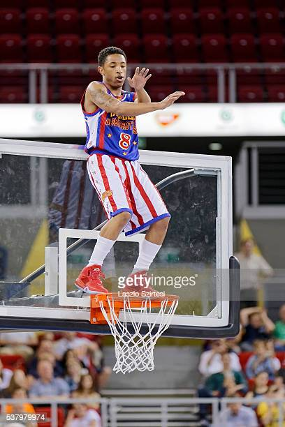 Carde 'Rocket' Pennington of Harlem Globetrotters dances on the rim during the exhibition game between Harlem Globetrotters and World AllStars at...