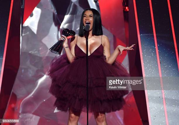 Cardi B accepts Best New Artist onstage during the 2018 iHeartRadio Music Awards which broadcasted live on TBS TNT and truTV at The Forum on March 11...