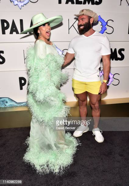 Cardi B and Dan Bilzerian attend the grand opening of KAOS Dayclub Nightclub at Palms Casino Resort on April 06 2019 in Las Vegas Nevada