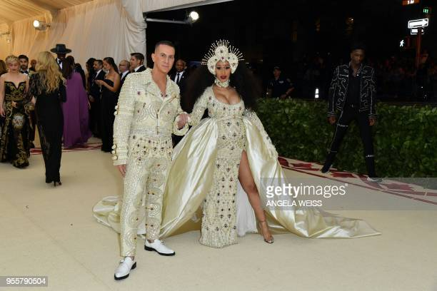 TOPSHOT Cardi B and Jeremy Scott arrive for the 2018 Met Gala on May 7 at the Metropolitan Museum of Art in New York The Gala raises money for the...