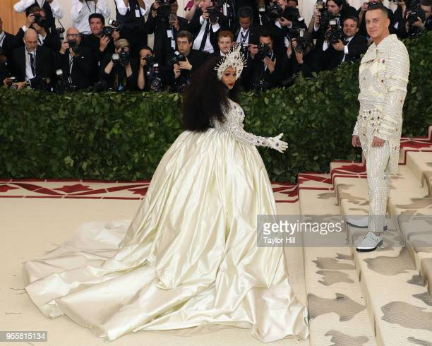 Cardi B and Jeremy Scott attend Heavenly Bodies Fashion the Catholic Imagination the 2018 Costume Institute Benefit at Metropolitan Museum of Art on...