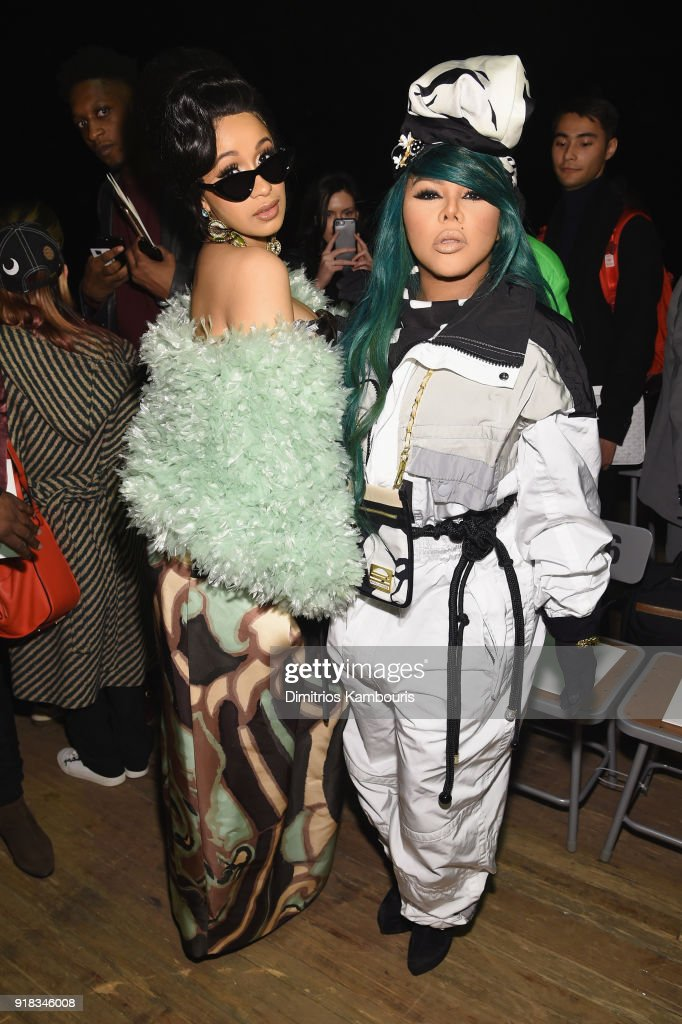 Cardi B (L) and Lil Kim attend the Marc Jacobs Fall 2018 Show at Park Avenue Armory on February 14, 2018 in New York City.