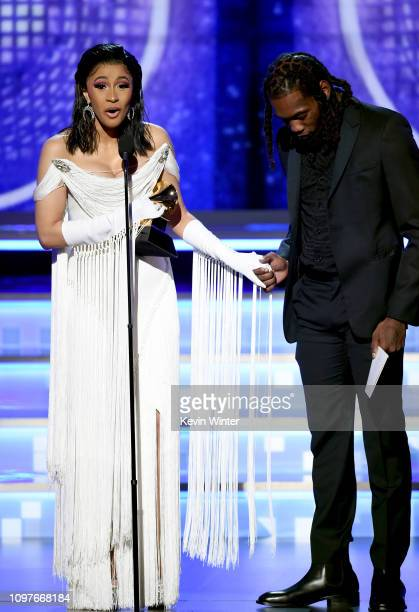 Cardi B and Offset accept the Best Rap Album for 'Invasion of Privacy' onstage during the 61st Annual GRAMMY Awards at Staples Center on February 10...