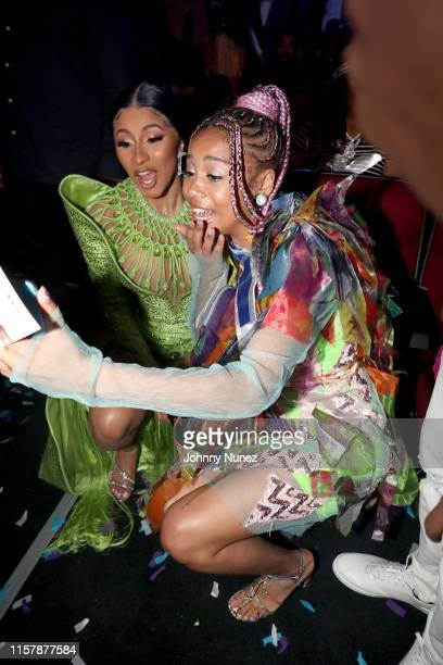 Cardi B and Sho Madjozi pose for a selfie at the 2019 BET Awards at Microsoft Theater on June 23 2019 in Los Angeles California