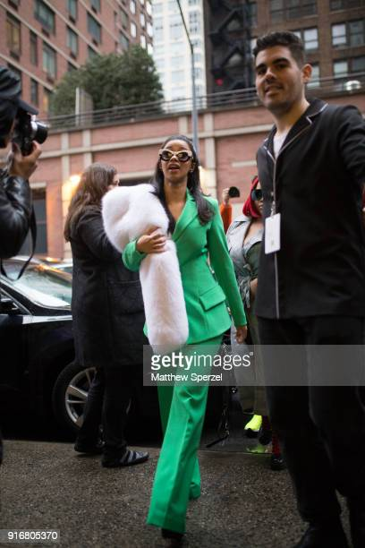 Cardi B is seen on the street attending Christian Siriano during New York Fashion Week wearing white fur and a green suit on February 10 2018 in New...