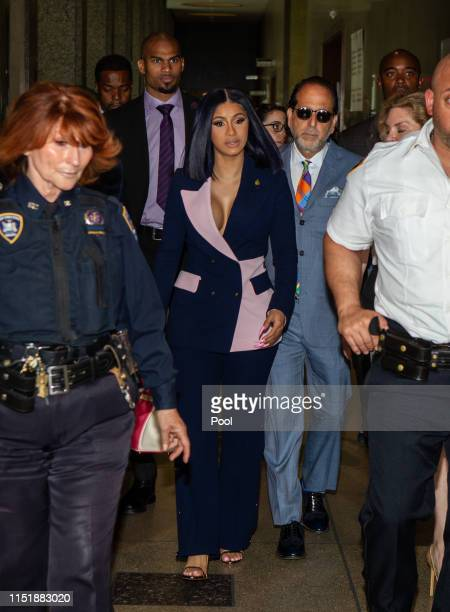 Cardi B leaves her arraignment on two felony assault counts and other misdemeanors at Queens County Supreme Court June 25, 2019 in the Queens borough...