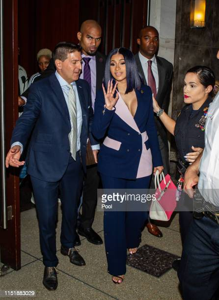 Cardi B leaves her arraignment on two felony assault counts and other misdemeanors at Queens County Supreme Court June 25 2019 in the Queens borough...