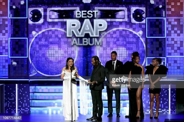 Cardi B Offset and Brooklyn Johnny accept the Best Rap Album for 'Invasion of Privacy' from Chloe Bailey and Halle Bailey of Chloe x Halle onstage...