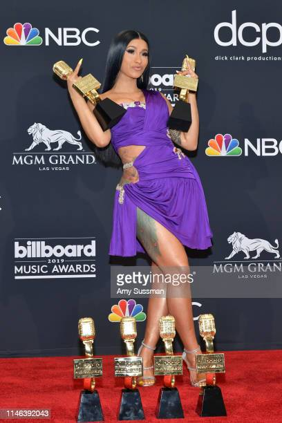 Cardi B poses with the awards for Top Rap Song 'I Like It' Top Hot 100 Song for 'Girls Like You' and Top Rap Female Artist in the press room during...