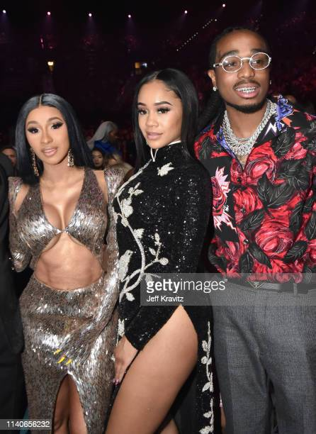 Cardi B Saweetie and Quavo of Migos attend onstage during the 2019 Billboard Music Awards at MGM Grand Garden Arena on May 1 2019 in Las Vegas Nevada
