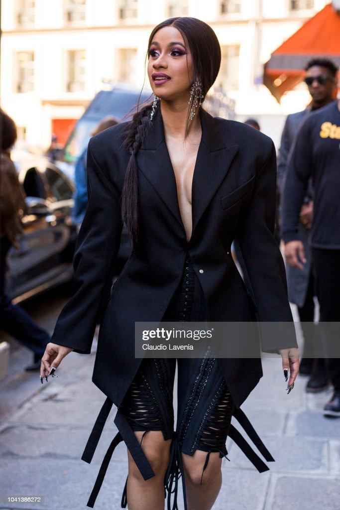 Cardi B Loyalty Over Royalty Bicep Tattoo: Cardi B, Wearing A Long Black Blazer, A Laced Black Shorts