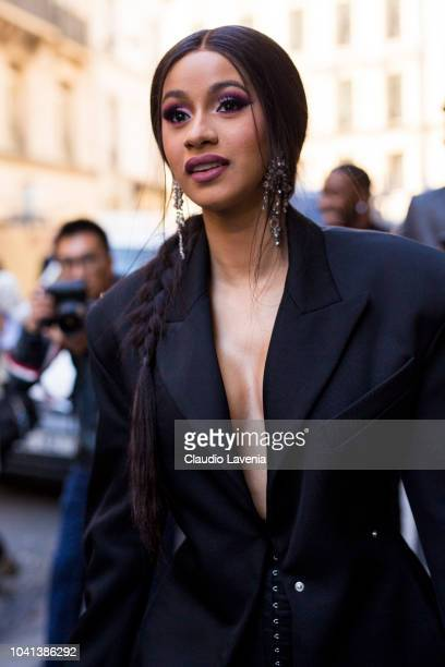 Cardi B wearing a long black blazer a laced black shorts and black heels is seen before the Mugler show on September 26 2018 in Paris France