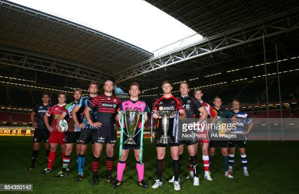 Cardiff Blues captain Matthew Rees with the Heineken Cup and Newport Gwent Dragons captain Andrew Coombs holding the Amlin Challenge Cup with fellow...