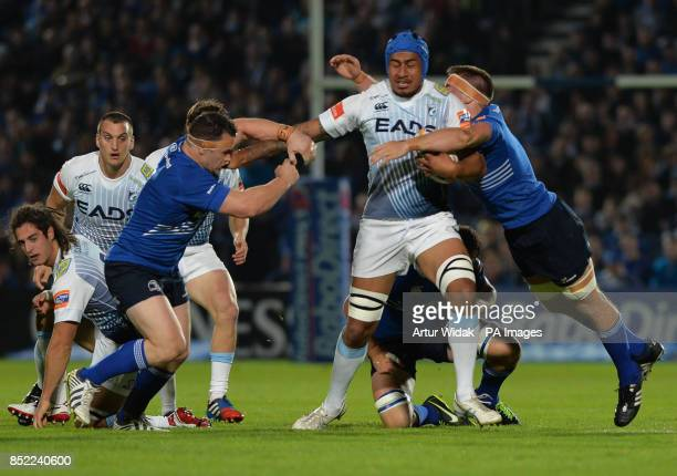 Cardiff Blues Filo Paulo is tackled by Leinster Rugby's Cian Healy and Dominic Ryan during the RaboDirect PRO12 match at the RDS Arena, Dublin,...